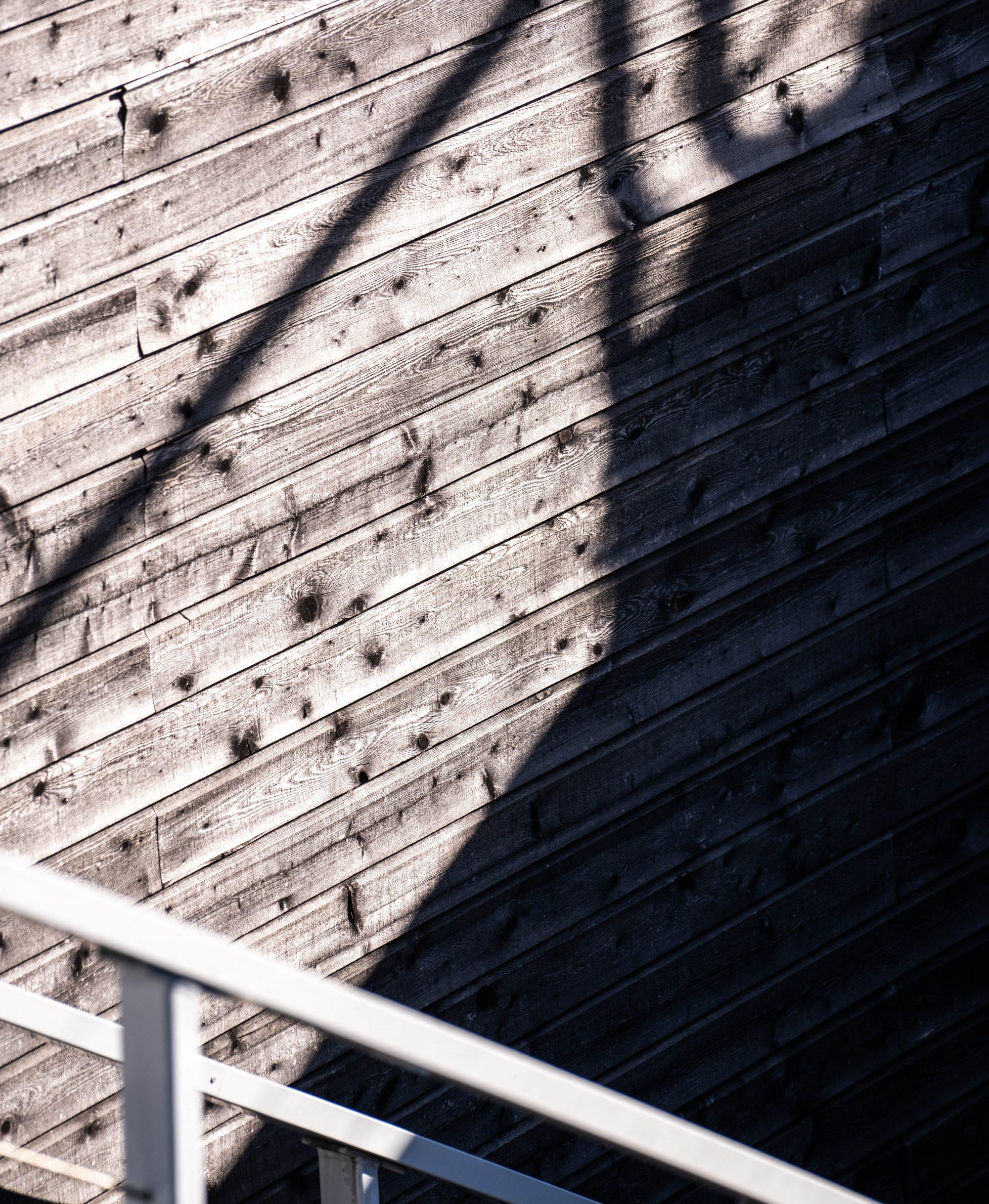 Shadow of stair railing on wood